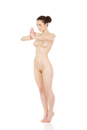 nude woman standing: Beautiful nude woman with hands clapped.