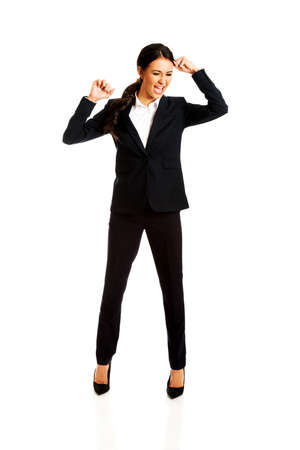 agressive: Agressive businesswoman screaming and pulling head. Stock Photo