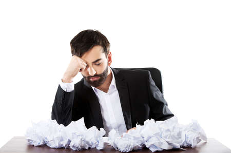 worried businessman: Young worried businessman cant find an idea. Stock Photo