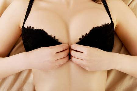 Hot women taking off bra