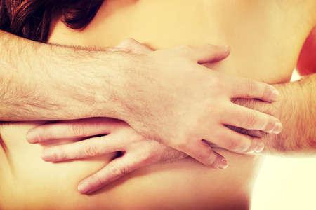 nude young: Человек касаясь грудь красивой женщины.