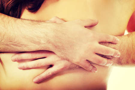 nude male body: Man touching beautiful womans breast.