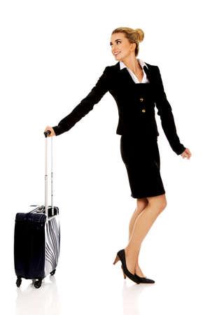 wheeled: Smile businesswoman dragging wheeled suitcase.