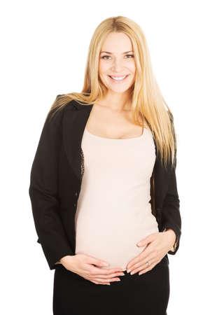formalwear: Smiling pregnant woman in formalwear. Stock Photo