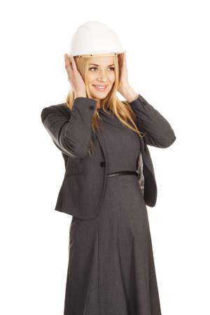 hard hat: Pregnant businesswoman wearing a hard hat