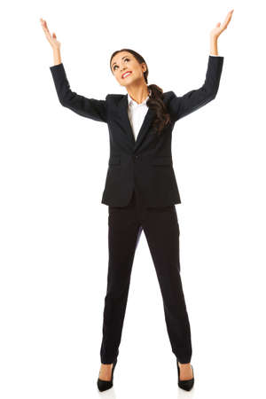 copyspace: Happy businesswoman holding copyspace high.