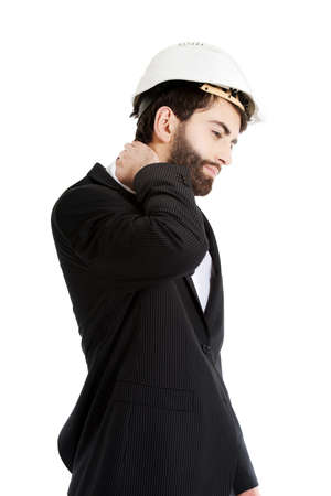 suffering: Businessman engineer suffering from neck pain.
