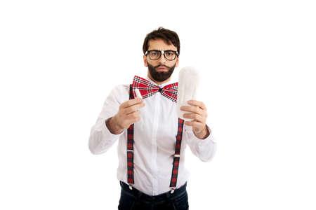suspenders: Handsome man wearing suspenders with menstruation pad.