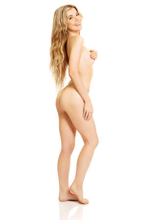 naked woman breasts: Full length of naked woman touching her breast.