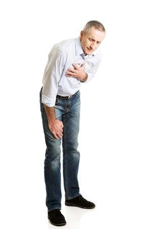 heartattack: Mature man with heart disease bending. Stock Photo
