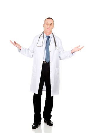 doctor holding gift: Mature male doctor holding copyspace in both hands.