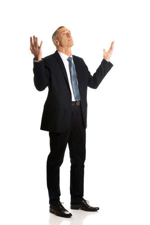 full length: Full length businessman with hands open gesture.