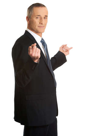 both sides: Mature businessman pointing with hands on both sides.