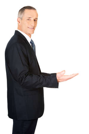both: Businessman holding something invisible in both hands. Stock Photo