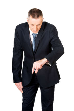 decreasing in size: Mature businessman showing small size with fingers. Stock Photo