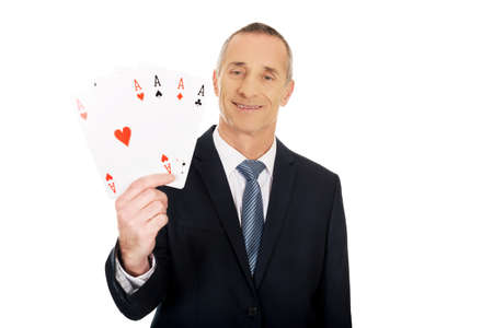 aces: Smart mature man with four aces.
