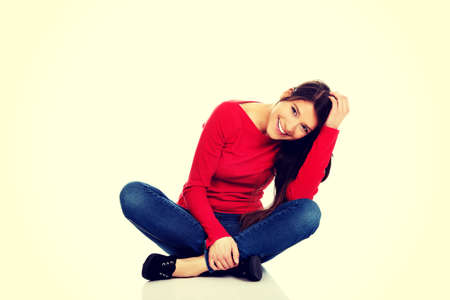 legged: Student woman sitting cross legged on the floor.