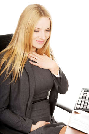 nausea: Pregnant woman in the office suffering from nausea Stock Photo
