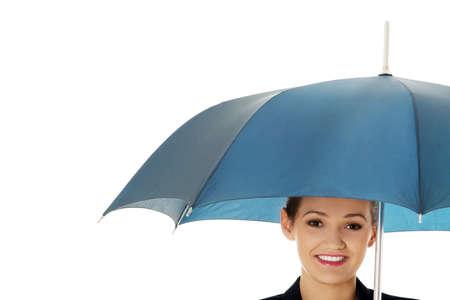 busineswoman: Beautiful business woman is holding blue umbrella.