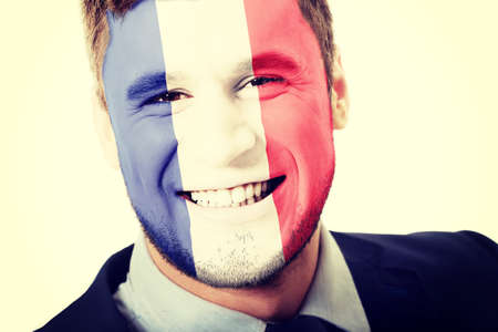 patriot: Happy man with France flag painted on face. Stock Photo