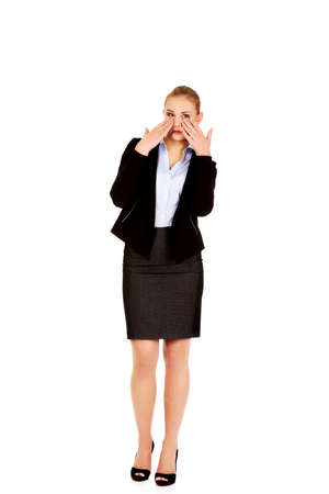 sinus: Young business woman with sinus pressure pain.