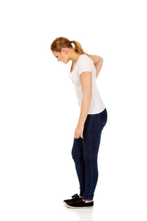 back ache: Young woman with back ache.