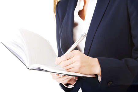 close uo: Close uo on notebook and pen in business woman s hands  Stock Photo