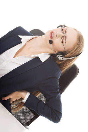 back ache: Beautiful business woman at call center is having back ache  Isolated on white  Stock Photo