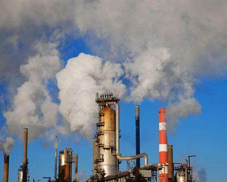 pollution: industrial site with smoking pipes, global warming concept