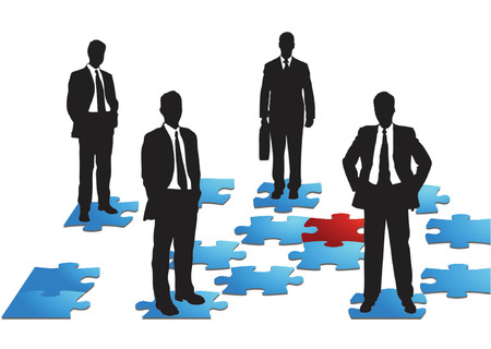 Four businessmen standing on puzzle pieces, business team
