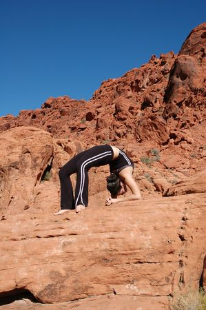 A girl doing yoga in Red Rock Canyon, Las Vegas Nevada Stock Photo - 664291