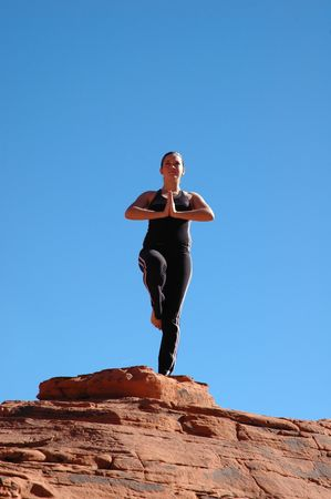 A girl doing yoga in Red Rock Canyon, Las Vegas Nevada Stock Photo - 664305