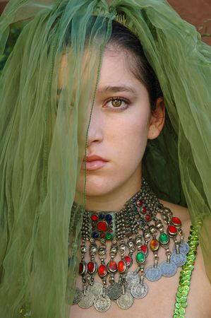 saddened: Mysteriously saddened girl with a green veil covering her face