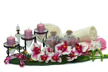Orchid, wash sponges, candles, bath salt, perfume bottles, lotion, shower gel, and towel Stock Photo - 665920
