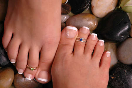 Mother and daughter having spa treatment (a pir of pedicured feet) photo