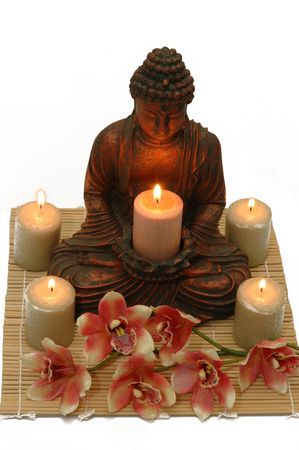 A tranquil scene; Buddha, candles and orchid photo