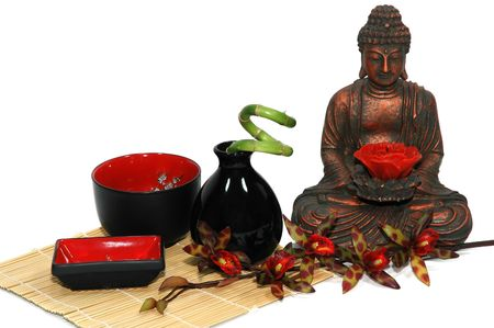 Orchid, candle, Buddha, Asian bowls and vase, bamboo plant photo