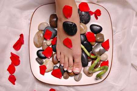 Pedicured foot with rose petals Stock Photo - 672844