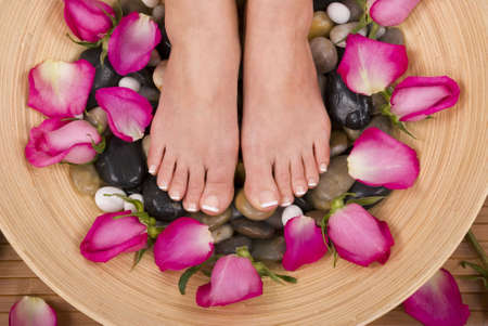 Spa treatment with fresh beautiful roses Stock Photo