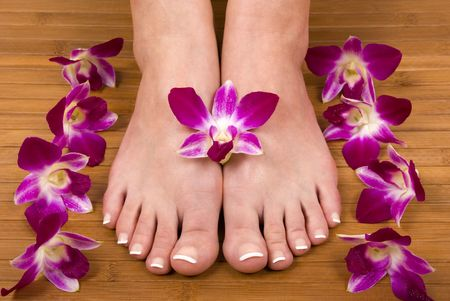 pedicure: Spa treatment with fresh beautiful orchids