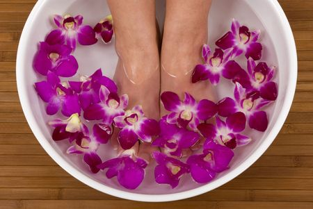 manicure and pedicure: Spa treatment with beautiful orchids Stock Photo