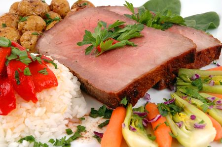 Roast beef, rice, organic vegetables and  potatoes roasted with garlic and rosemary                               Stock Photo - 819322