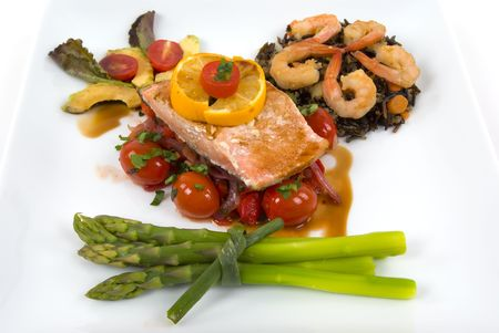 Salmon,asparagus, wild rice with shrimp, onion,roasted peppers and tomatoes with pomegranate sauce photo