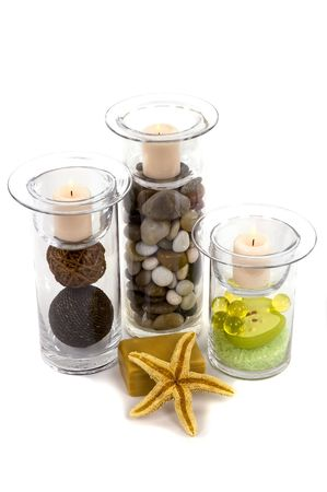 Candleholders with pebbles, decor accents, bath pearls and salt in them, starfish, and natural olive oil soap Stock Photo