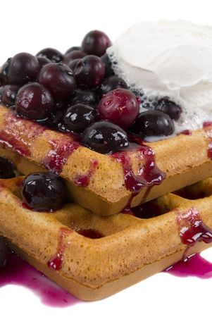 Homemade whole wheat waffles with fresh blueberries, honey and cream Stock Photo - 819347