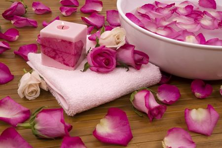 Spa Treatment with aromatic roses, petals, and candle photo