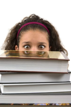 Student burried in homework (looking at the books with fear)