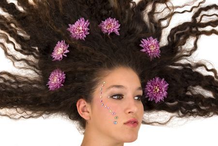 hair treatment: Girl with flying hair and flowers on it