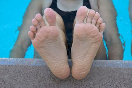 Swimmer resting during practice (pruned feet) photo