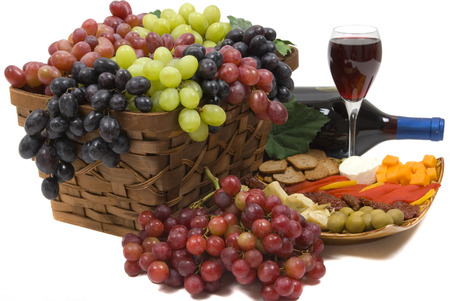 seedless: Three different kinds of seedless grapes, wine, and antipasto Stock Photo